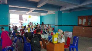 Kegiatan vaksin covid-19 di pelataran kampus STIM LPI Makassar